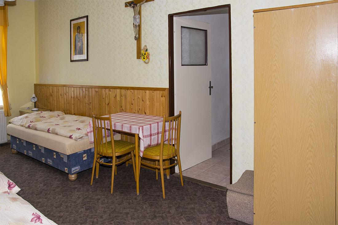Třílůžkový apartmán v penzionu