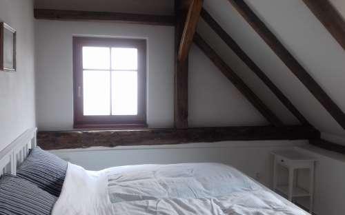 Pokoj Jakub - Dvoulůžkový podkrovní pokoj s koupelnou.