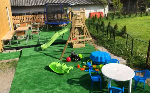 Outdoor area with terrace and children's corner at the apartments