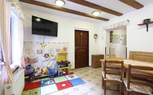 Společenská místnost s dětským koutkem