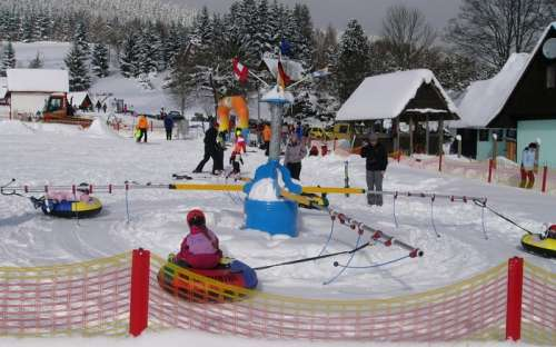 Children's park with carousel, children's ski lift and moving belt with long 130 m.