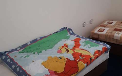 We have a novelty for small guests in the room. - Baby bedding and toys