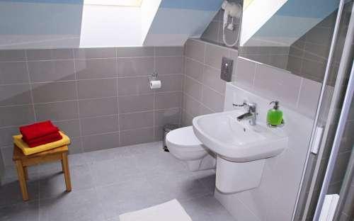 Apartmán A1 - společný kout s kuchyňkou